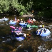 Tubers ride the Boulder Creek for Tube to Work Day 2018