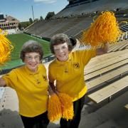 Twins Peggy Coppom, left, and Betty Hoover. (Photo by Glenn Asakawa/University of Colorado)