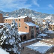 Snowy University Memorial Center with flatirons in background