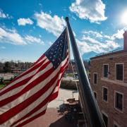 American flag flying at UMC