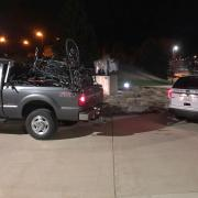 abandoned bikes being collected in the back of a pickup truck