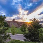 Sun peeking over campus views