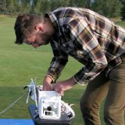 Graduate student Villiam Klein sets up 360-degree camera to be launched via balloon