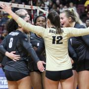 CU women's volleyball team celebrates at a match