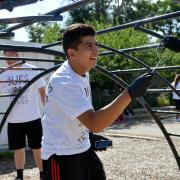 Students re-paint climbing gym at University Hill Elementary School