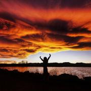 Silhouette of a person during sunset at Waneka Lake in Lafayette, Colorado.