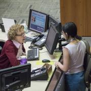 Women talking to librarian