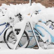 Bike rack covered in snow