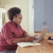 Woman sitting at a laptop computer