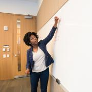 Stock image of a person teaching others