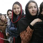 Women of Afghanistan stand outside the U.S. Embassy in Kabul, Wednesday, March 1, 2006. President George W. Bush and Laura Bush made a surprise visit to the city and presided over a ceremonial ribbon-cutting at the embassy. (Staff Sgt. Russell Lee Klika, US Army National Guard; Source: Wikimedia Commons)