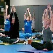Students participate in a yoga class at the Rec Center