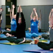 Students partaking in yoga class at The Rec