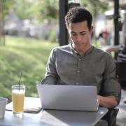 person working on laptop outside
