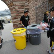 Students help fans sort their recyclables and compostables at a CU football game.