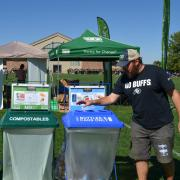 Recycling, compost and trash bins near Folsom Field