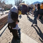 Chip greets a young fan during Homecoming weekend on the CU Boulder campus on Saturday, Nov. 9, 2019. (Photo by Glenn Asakawa/University of Colorado)