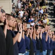 Fifty new recruits from the state of Colorado are sworn in to their respective military services during the first half of the Colorado-Stanford football game at Folsom Field on Saturday, Nov. 9, 2019. (Photo by Glenn Asakawa/University of Colorado)