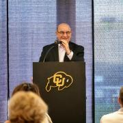 Chancellor DiStefano addresses Athletics staff at the Touchdown Club