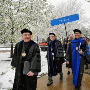 Chancellor DiStefano and faculty walk in commencement procession