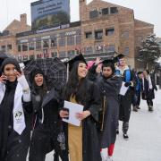 Graduates seated for commencement ceremony at Folsom Field