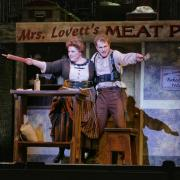 Cast members perform in the dress rehearsal of Sweeney Todd. Photo by Glenn Asakawa.
