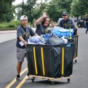 Campus volunteers help out during move-in.