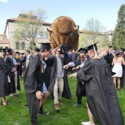 Grads gather at Norlin Quad before the main commencement ceremony. Photo by Glenn Asakawa.