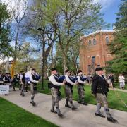 Bagpipers lead the procession from the quad to CU Boulder's 2018 main commencement ceremony at Folsom Field. Photo by Glenn Asakawa.