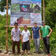 Group of people stands in front of Punta Laguna banner