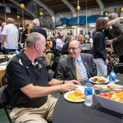 Chancellor DiStefano chats with CU basketball coach Tad Boyle at football kickoff luncheon.