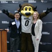 Donor Tandean Rustandy and Dean Sharon Matusik pose for photo with Chip. Photo by Casey A. Cass.