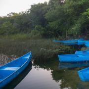 Laguna with blue canoes