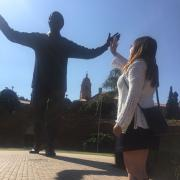 Student Connie Hernandez gives Nelson Mandela statue a high-five