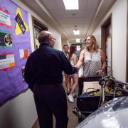Chancellor DiStefano shakes hands with a Buff mom during move-in.