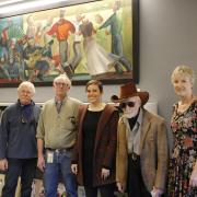 Centenarian artist Lynn Wolfe (fourth from the right) came to see his artwork in the re-opened music library. Also pictured are Stephanie Bonjack, Carl Stewart and two of Wolfe's relatives. Photo courtesy of University Libraries.