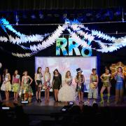 Recycled runway participants line up on stage