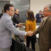 Governor Ricardo Rossello shakes hands with Assistant Vice Chancellor Dave Aragon, photo by Casey A. Cass