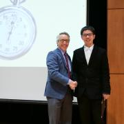 Graduate School Dean Scott Adler with runner-up Jason Zhang