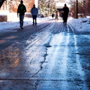 Students walking after a weekend snowstorm blanketed the campus with several inches of fresh snow. Photo by Patrick Campbell.