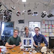 Andrew Pfefer, Anastasia Muszynski and Dawson Beatty pose with their origami device
