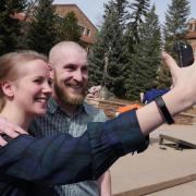 Tim Lyons poses for a selfie post-shave with his wife Dana, who works in Admissions. Photo by Casey A. Cass.