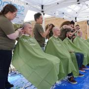 Students participate in the St. Baldrick's event outside the UMC. Photo by Casey A. Cass.