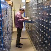Tim Clark looks through file drawers