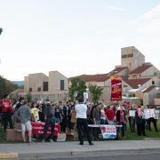 Peaceful protesters gather outside; photo by Glenn Asakawa