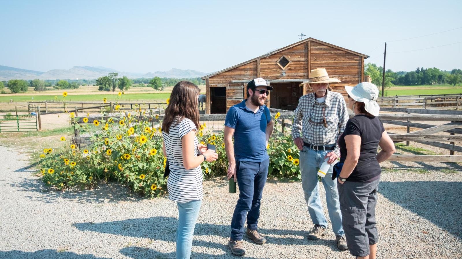 Aaron Treher and Molly McDermott speak with the Cargills at their farm.