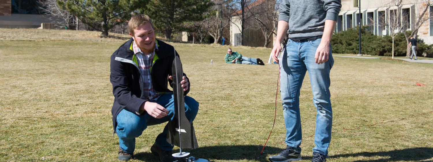 student prepping for rocket launch on e-days