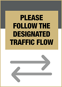 """Image of a sign that states """"Please follow the designated traffic flow"""""""