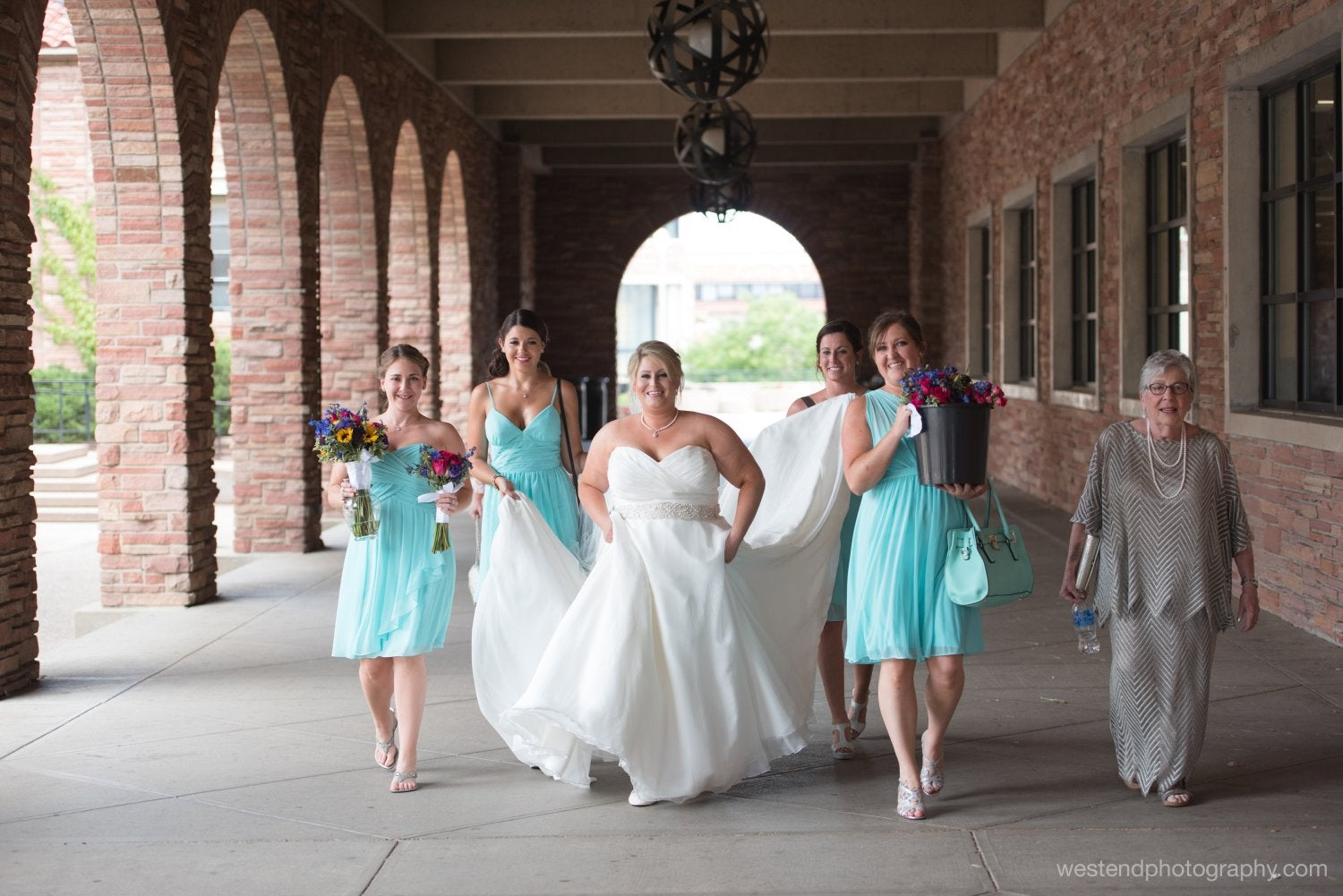 Bridal party in the arcade outside the UMC