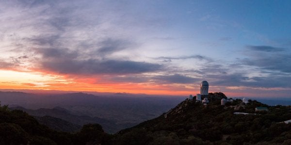 "A photograph titled ""Sunset at Kitt Peak National Observatory"" by Suphawit Duangphumek"